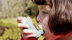 Girl with asthma inhaler - stock footage