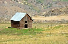 little brown shack on ranch - stock photo