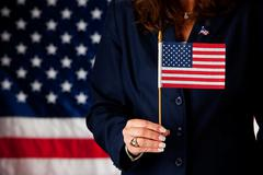 Stock Photo of politician: holding a small us flag