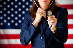 politician: playing doctor with stethoscope - stock photo
