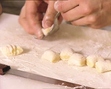 PASTA woman hands shaping gnocchi - stock footage