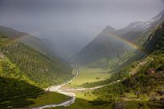 rainbow in alps - stock photo