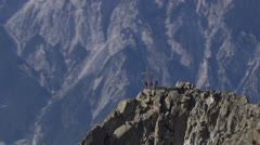 Aerial rotation around hikers on mountain peak with zooms, Tyrol Austria Stock Footage