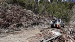 Drilling rig tracking up hill preparing seismic testing for oil. - stock footage