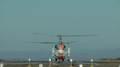 The helicopter with two bearing screws goes to flight Stock Footage