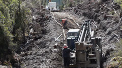 Drilling rig tracking up hill. Stock Footage