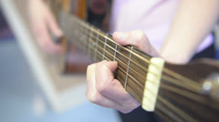 Female plays guitar acustic Stock Footage