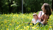 Stock Video Footage of Young mother and her daughter having fun outdoors