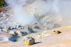 smoking fumaroles of bumpass hell, lassen volcanic park, california. - stock photo
