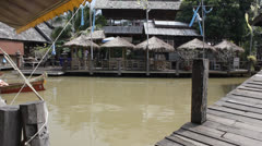 Tourist boat goes under a bridge in Pattaya floating market. Stock Footage