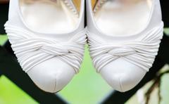 brides shoes closeup - stock photo