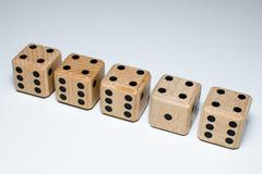 Line of wooden dice Stock Photos