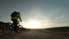 Cross-country cycling at sunrise Stock Footage