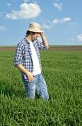 Stock Photo of farmer in a wheat field.