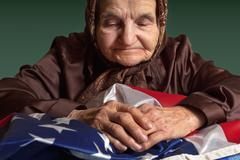 Elderly woman with american flag Stock Photos