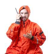 Man in storm cog talking on marine radio Stock Photos