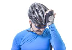 adult bicyclist in frustration - stock photo