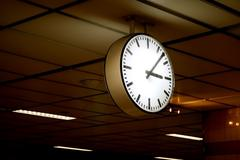 public clock in a railway station - stock photo