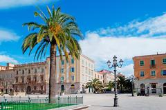 Piazza d'italia and palm Stock Photos