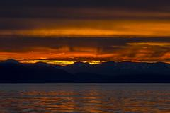 orange sunset over mountains, alaska - stock photo