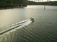 Aerial ski boat going under bridge Stock Footage