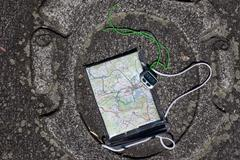 map and pedometer - stock photo