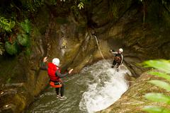 Well Equipped Man Jumping Into A Natural Pool During A Canyoning Expedition - stock photo
