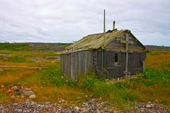 old abandoned fishermans cabin at white sea coast, northern russia - stock photo