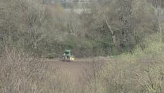 Tractor turns to make another tilling run. Stock Footage
