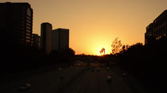 Freeway in Caifornia at sunset, commuters going home Stock Footage