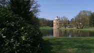 Stock Video Footage of Medieval Castle of Rozendaal + pan pond and park to road