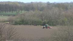Tractor tows seed drill. Stock Footage