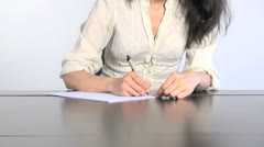 woman writing white paper 30 - stock footage