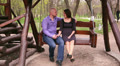 loving couple ride on a swing in the park 3 Footage