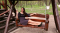 Young beautiful woman riding on a swing 2 Footage