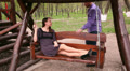 loving couple ride on a swing in the park 2 HD Footage