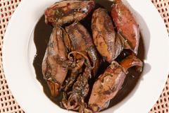 plate of squid stew in soy sauce. - stock photo