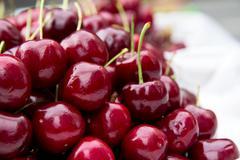 Fresh cherries in food market Stock Photos