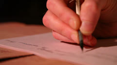 Man writes a letter to feather 1 Stock Footage