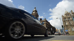 Time lapse traffic and pedestrians passing leeds town hall united kingdom Stock Footage