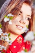 Girl in the flowers of cherry - stock photo