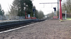 Train arrives in station - stock footage