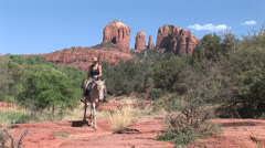 Cowgirl with horse at Red Rock Crossing Cathedral rock 5 in series Stock Footage