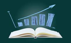 Business success growth graph and open book Stock Photos