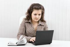 Stock Photo of the serious girl with the laptop