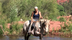 Horse plays in Oak Creek at Red Rock Crossing 2 in series Sedona Arizona Stock Footage