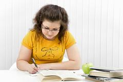 The girl the student with writing-books and books Stock Photos