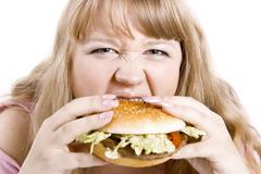 the young woman and hamburger - stock photo