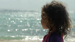 Kid looks out to Ocean Stock Footage