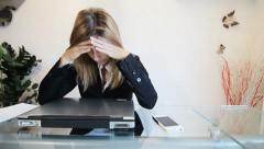 Stressed business woman in office Stock Footage